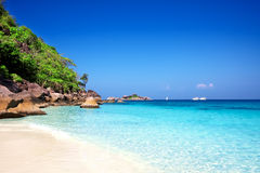 Tropical white sand beach arainst blue sky. Simila Royalty Free Stock Image