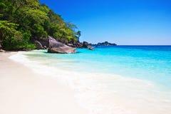 Tropical white sand beach arainst blue sky Stock Photos