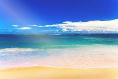 Tropical white sand beach and blue sky. stock photo