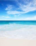 Tropical white sand beach and blue sky at summer sunny day. Seychelles Stock Photos