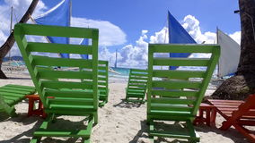 Tropical White Sand Beach. Chairs for lounging on Tropical White Sand Beach stock video