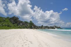 Tropical white sand beach, La. La Digue's Grand Anse beach framed by large granite rocks stock photos