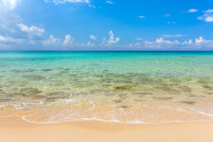 Tropical white sand beach with turquoise water under blue sky. Paradise background Royalty Free Stock Image