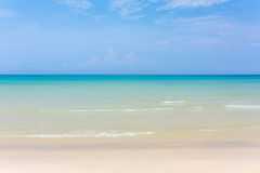 Tropical white sand beach with turquoise water under blue sky. Paradise background Royalty Free Stock Photo