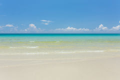 Tropical white sand beach with turquoise water under blue sky. Paradise background Royalty Free Stock Photos