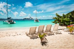 Free Tropical White Sand Beach With Beach Chairs. Jost Van Dyke, British Virgin Islands. Royalty Free Stock Photo - 161110705