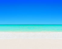 Tropical white sandy beach and clear ocean water natural background stock photography