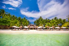 Tropical white sunny beach in beautiful exotic Royalty Free Stock Photo