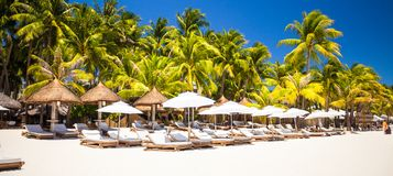 Tropical white sunny beach in beautiful exotic Stock Images