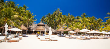 Tropical white sunny beach in beautiful exotic Royalty Free Stock Photos