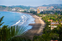 Tropical wide sandy beach. Of the town of Jaco, Costa Rica royalty free stock photos