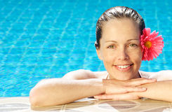 Tropical woman. Smiling woman at poolside Royalty Free Stock Image