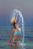 Tropical woman flips hair Stock Photography