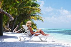 Tropical woman on lounge Stock Photos