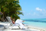 Tropical woman on lounge Royalty Free Stock Photos