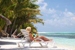 Tropical woman on lounge Stock Images