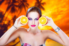 Tropical woman with oranges. Tropical brunette woman with oranges Royalty Free Stock Photography