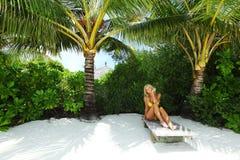 Tropical woman on lounge Stock Photos