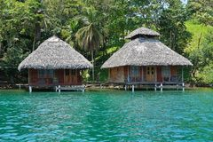 Tropical wooden bungalows over the water Stock Image
