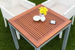 Tropical wooden dinning table on green grass Stock Photography
