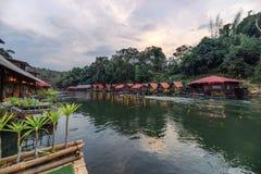 Tropical wooden raft resort illumination on river kwai. At dawn. Sai Yok Yai, Kanchanaburi stock image