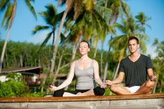 Tropical Yoga Couple Royalty Free Stock Photo