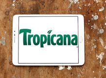 Tropicana logo. Logo of Tropicana juice company on samsung tablet on wooden background. Tropicana Products, Inc. is an American multinational company which Stock Photos