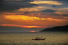 Tropics Sunset. Fishing boat on the seas near Sorsogon, Philippines during sunset royalty free stock image