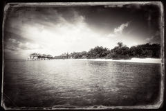 Tropikalnego wyspa krajobrazu retro stylizowany Zdjęcie Stock
