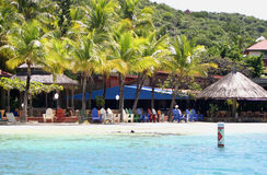 Tropische strandscène Stock Afbeeldingen