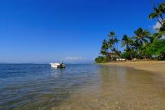 Tropische Strandszene lizenzfreies stockfoto