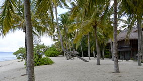 Tropisches Haus auf dem Strand Stockfoto