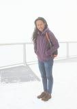 Tropisk flicka i vinter Arkivbild