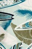 Tropisk gräsplansidamodell på blått tyg Arkivbild