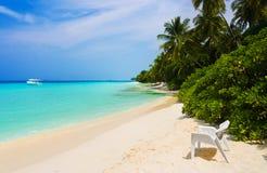tropisk strandstol Royaltyfria Foton