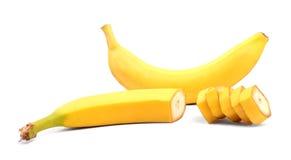 Tropiska två, exotiska, organiska och nya bananer, på en vit bakgrund vitaminer Begreppet av bantar och vitaminer Arkivbilder