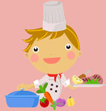 Troszkę chłopiec settingin kuchnia Zdjęcie Royalty Free