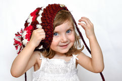 Troszkę dziewczyna w trykotowej purpury nakrętce Obraz Royalty Free