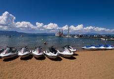 'trotinette's na praia Imagem de Stock Royalty Free