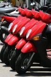 'trotinette's vermelhos fotos de stock
