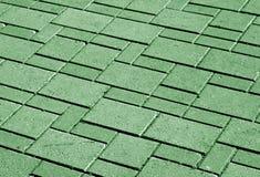 trottoarmodell för grön färg med suddighetseffekt Arkivfoto