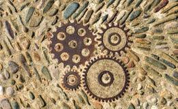 Trottoartextur med kugghjul och tegelstenar i Montjuic, Barcelona, Spanien Arkivbild