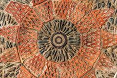 Trottoartextur med kugghjul och tegelstenar i Montjuic, Barcelona, Spanien Royaltyfria Bilder