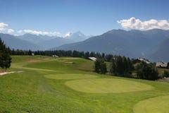 Trou 8 de golf dans Crans Montana Photos stock