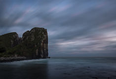 Trou dans exposition de falaise de mur la longue Photos stock