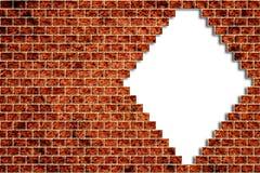 Trou dans un mur de briques Photos libres de droits