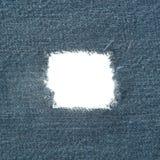 Trou de jeans photo libre de droits