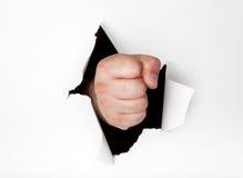 Trou de poinçon de main par le papier Image libre de droits