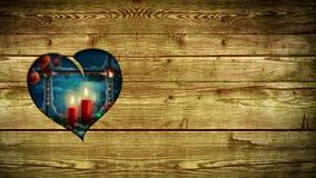 Trou en forme de coeur en bois, montrant la scène de Noël Photos libres de droits