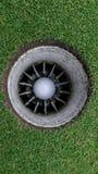 Trou et boule de golf Image libre de droits